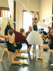 Students rehearse at the Dali Ballet Company for a performance of the Nutcracker.
