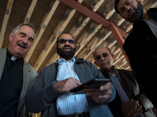 Pastor Fred Schenker and members of the Islamic Center of Western Pennsylvania tour the organization's under-construction mosque.
