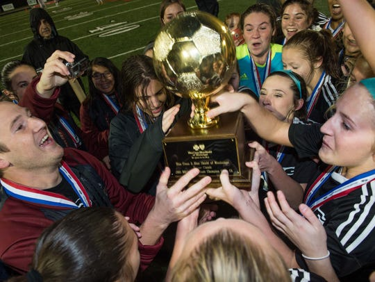 The Germantown girls celebrate the school's first soccer
