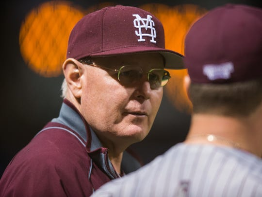 Mississippi State interim head coach Gary Henderson speaks with a player before the Bulldogs game against Jackson State during their game Wednesday night in Jackson.