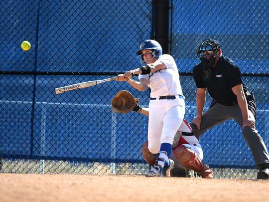 Samantha Reilly swings the bat for Georgian Court softball.