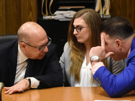 Keri Barry with her attorneys John Bruno Jr. on left, and Jonathan Bruno, on right, in Passaic County Superior Courthouse after Judge Portelli supressed two key pieces of evidence in a murder trial against Barry. Barry is charged with killing her newborn son eight years ago. Portelli ruled a plastic garbage bag in which the newborn was found, and a laptop computer police removed from Barry's parents' home containing electronic messages in which Barry allegedly chatted with a friend about terminating the pregnancy before she delivered the baby in the bathroom of her parents' house on Dec. 11, 2009 were obtained through an unlawful search.