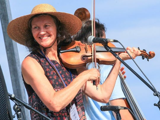 Lynne Martin plays with Conservation Theory bluegrass band during the 36th annual Spittoono festival in Central.