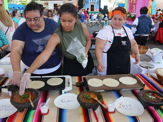 Lucy (from left), Gabby and Ana Cardenas prepare fresh tortillas and salsa in the Cultural Pavilion at Mexican Fiesta in 2015.