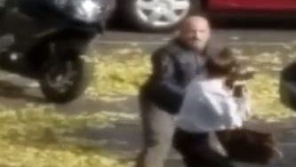 This screengrab is from video showing an interaction between a woman and an off-duty officer. The off-duty officer has been identified as Stephan Sparacio.