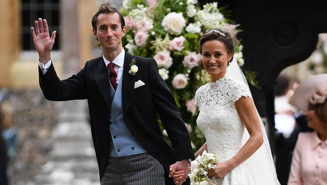 Pippa Middleton and her new husband James Matthews leave church following their wedding ceremony at St Mark's Church on May 20, 2017 in Englefield Green, England.