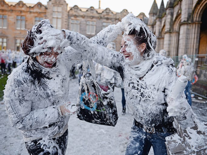Freshman students cover each other with shaving cream at a traditional event on Nov. 4 at St. Andrews University in Scotland. Students dress up in formal clothing, then stage a massive shaving cream fight at the school's St. Salvatore's Quadrangle as they observe a tradition that began in 1413.