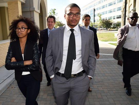 Khari Noerdlinger, center, appears outside court in