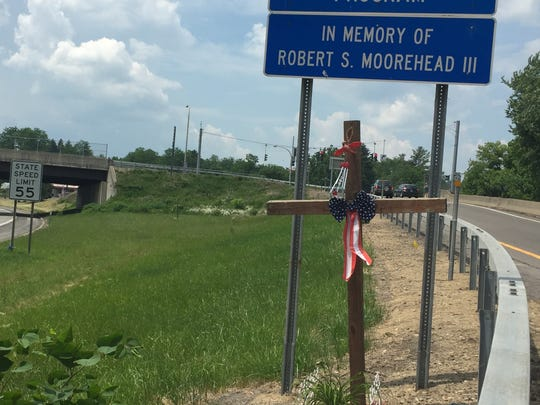 A cross in memory of Robert Moorehead III, who was