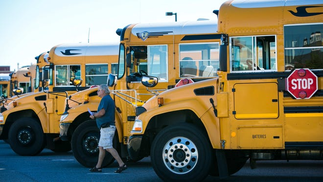 Appoquinimink School District buses line up to pick up students. Transportation is just one of many things the district may have to cut if Gov. John Carney's budget proposal is approved in its current form.