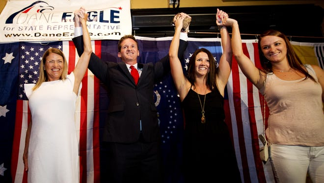 Dane Eagle celebrates his primary win for State Representative with his mother, Cathy, left, and sisters, Kiki and Gibby Eagle at Club Fletchers in Cape Coral on Tuesday 8/26/2014.