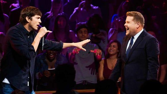 Ashton Kutcher and James Corden are ready to do battle.