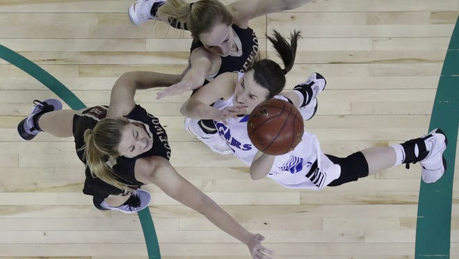 Wrightstown's Danielle Nennig, right, puts up a shot against Madison Edgwood's Hannah Frazier, left, and Rachel Roehrig, top, during their WIAA Division 3 state semifinal game at the Resch Center in Ashwaubenon.