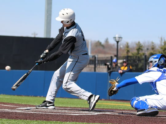 Plymouth's Pete Carravallah connects against Salem during the opener of Saturday's doubleheader at U-M.