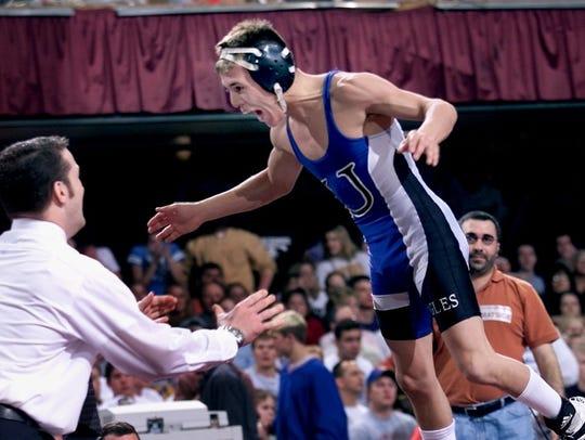 2002: Dan Davila , of Underwood, jumps into the arms