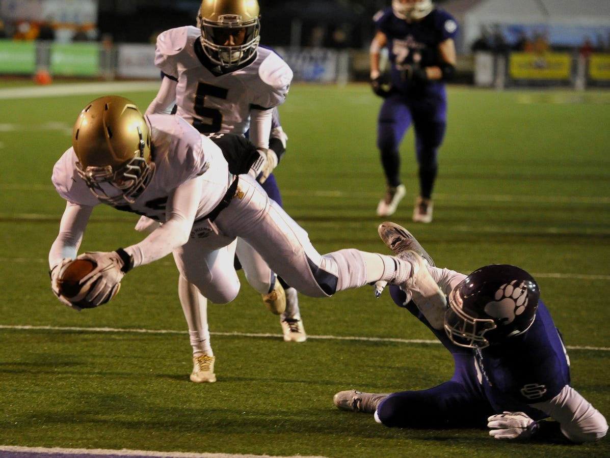 Independence's Seth Huner (19) dives for a touchdown against Sevier County in the 5A BlueCross Bowl game on Friday. Independence won 49-14.