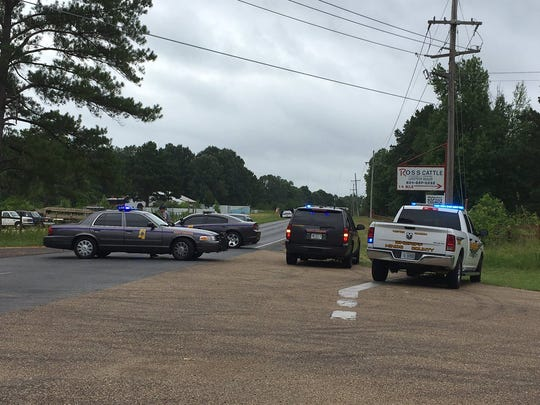 Law enforcement officials blocked off Midway Road Wednesday morning for a standoff with a suspect who barricaded himself inside a home after allegedly exchanging gunfire with a U.S. Marshals Taskforce.