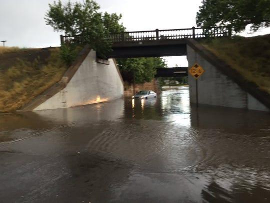 Rain overwhelms Great Falls streets.