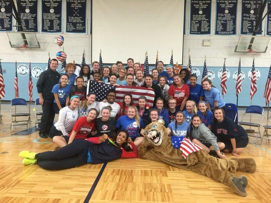 Fresh from her appearance with the U.S. women's volleyball team in the 2016 Summer Olympics in Rio de Janeiro, bronze medalist Rachael Adams visited Mount Notre Dame Aug. 29. The former Cougar and Texas Longhorn addressed an assembly in the morning, then posed (front left) with the MND volleyball team.