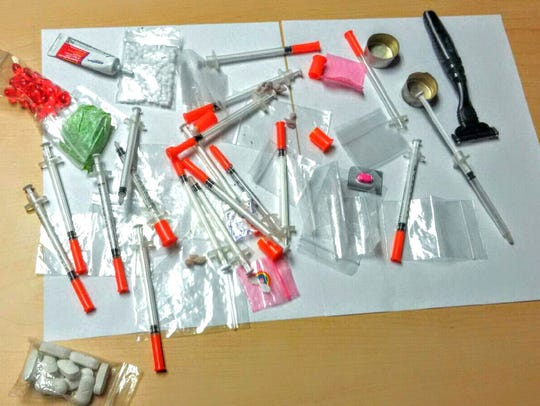 Drug paraphernalia and needles with residue that tested