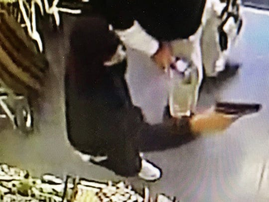 This surveillance image shows a suspect during the armed robbery of a Dollar General store in Jackson, Miss.