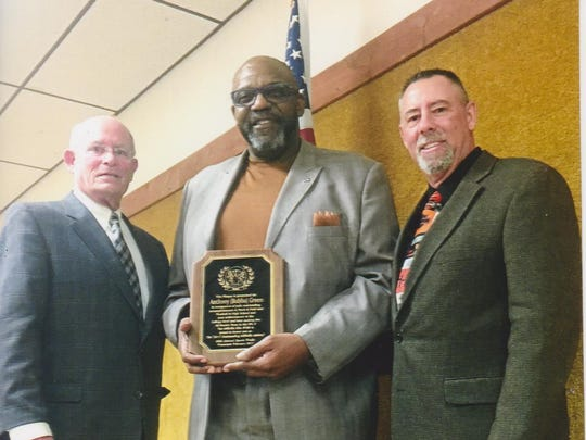 """Anthony """"Bubba"""" Green (center), received the Millville Elks Lodge No. 580's Outstanding Athlete Award, from Rob Shannon (left), chairman of the Millville Elks Sports Frolic, and Keith Rafine, Exalted Ruler, Millville Elks Lodge, during the 69th annual Sports Frolic."""