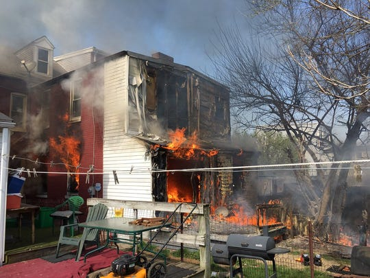 Fire consumes the rear of 316 E. Maple St. Saturday afternoon. Photo courtesy York City Fire