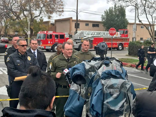 Los Angeles County Sheriff Jim McDonnell talks to reporters Saturday afternoon in Pomona concerning a police officer killed in the line of duty during a standoff.