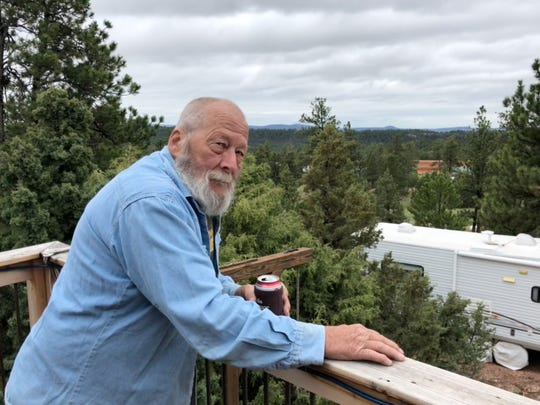 Retiree Karl Van Rump lives next to the secretive FLDS compound in Custer County, seen to his right from his elevated porch, and has concerns about how women and children are treated by the polygamous religious sect.