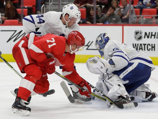 Red Wings center Dylan Larkin (71) tries hitting the puck past Maple Leafs goalie Frederik Andersen (31) during the second period of the Wings' 4-2 exhibition loss on Friday, Sept. 29, 2017, at Little Caesars Arena.