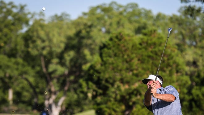 Nathan Pomroy hits the ball at second hole during the 59th San Angelo Country Club Men's Partnership Thursday, June 21, 2018. Pomroy and partner Garrison Lackey shot a round of 64 Saturday to take a one-shot lead into the final round.