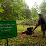 Army veteran Dan Roberts joined other Brown-Forman volunteers recently to clear undergrowth at the Active Heroes Retreat Center in Shepherdsville.