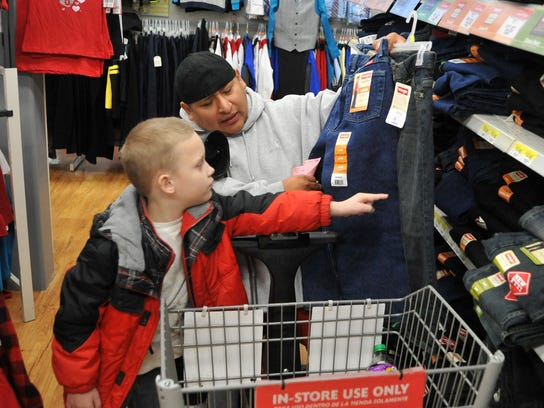 Shopping volunteer Pablo Neal helped then 8-year-old