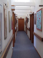 The hallways of offices and exam rooms at Kenny Chiropractic.