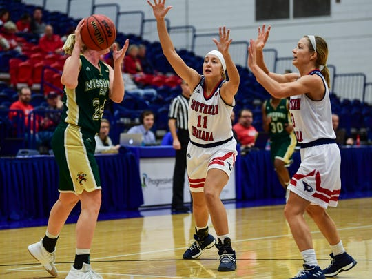 USI's Morgan Sherwood (11) and Randa Harshbarger (3) press Missouri S&T's Janie Arand (24) at USI's Physical Activities Center in Evansville, Ind., Thursday, Jan. 18, 2018.