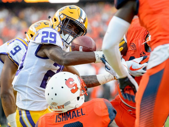 LSU cornerback Andraez Williams (29) comes down with