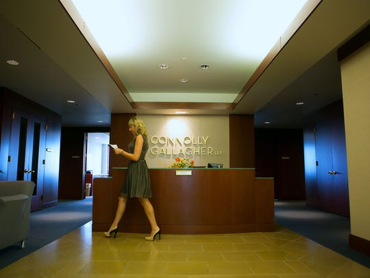 Employee Joanna Ferrese works in the lobby of law firm Connolly Gallagher in Wilmington.