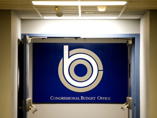 A sign in a congressional office building identifies the offices of the nonpartisan Congressional Budget Office.