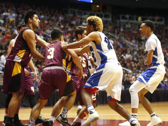 Skirmish on the court during the high school boys basketball: 4A Conference state championship game Salpointe verses Shadow Mountain at Gila River Arena in Glendale on February 25, 2017. Salpointe Isaac Cruz (3) and Shadow Mountain Jaelen House (2) were both ejected.