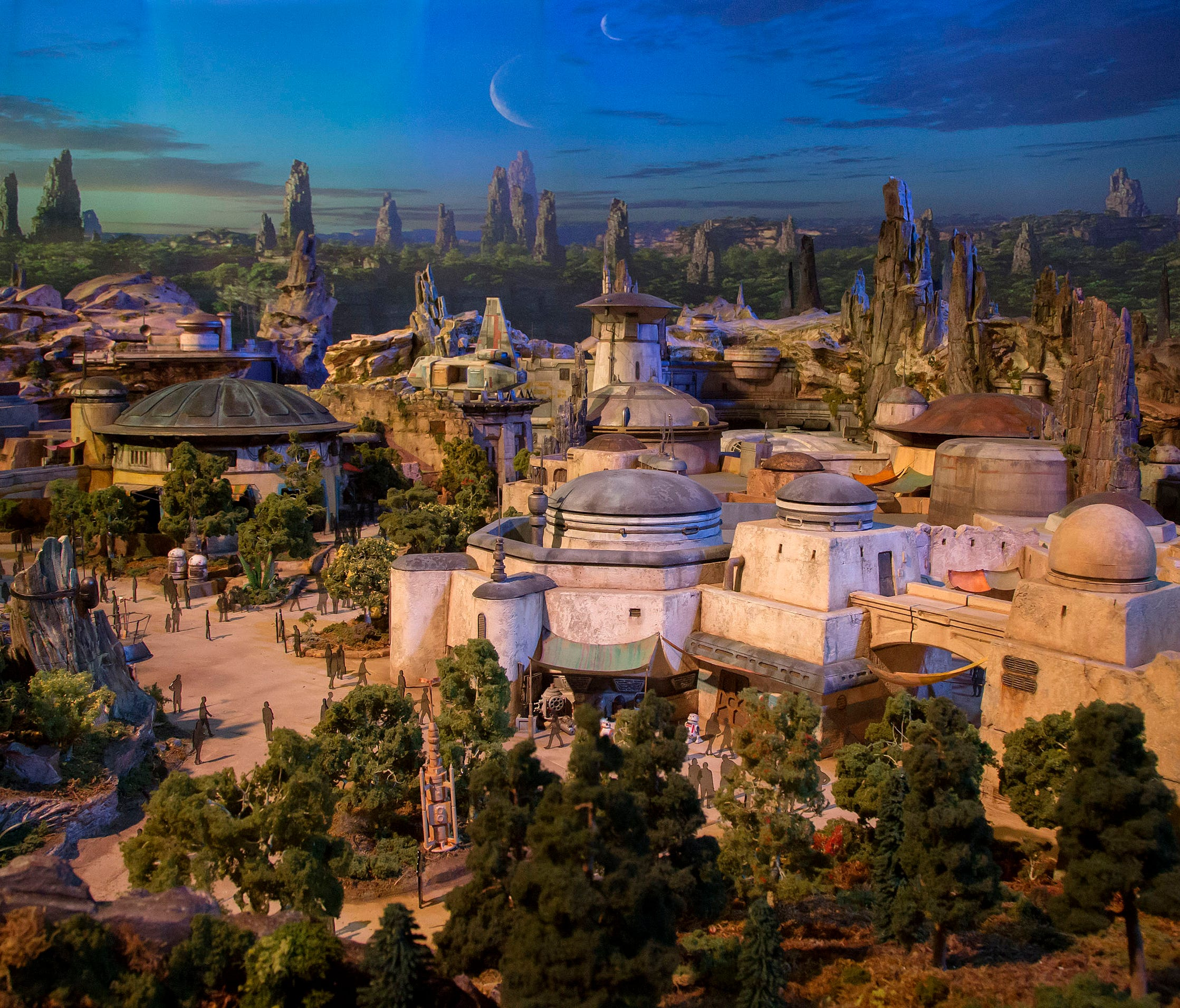A detailed model of Disney's Star Wars: Galaxy's Edge provides an early look at the new 14-acre land. To accommodate its ongoing construction (it will open May 2019), several attractions were temporarily closed, including the Disneyland Railroad and