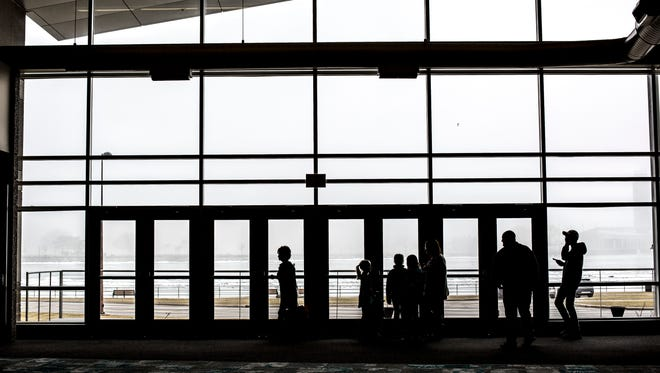 Participants look out windows at fog over the St. Clair River during the Home, Sport, and Garden Show Saturday, March 18, 2017 at the Blue Water Convention Center in Port Huron.