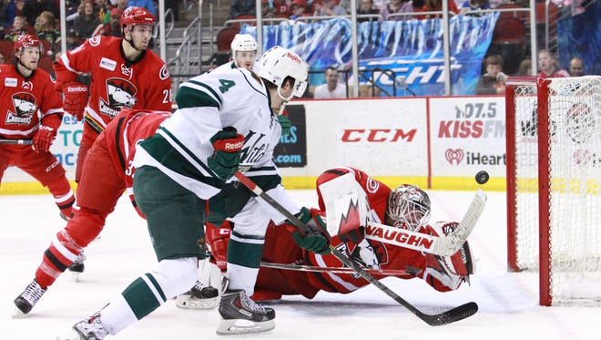 CHARLOTTE GOALIE DREW MACINTYRE KNOCKS DOWN TYLER GRAOVAC'S SHOT JUST BEFORE THE SECOND PERIOD EXPIRED ON SUNDAY AFTERNOON.