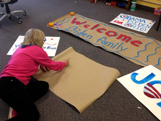 Karen Evans works on signs at the Obama/Biden campaign office Nov. 2, 2012, on North Memorial Drive in Lancaster. Volunteers spent the day gearing up for Vice President Joe Biden's visit to Rushville.