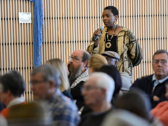 St. Cloud State University professor Debra Leigh asks Gov. Mark Dayton a question Tuesday about the security and safety of students and teachers at SCSU in the wake of recent college shootings.