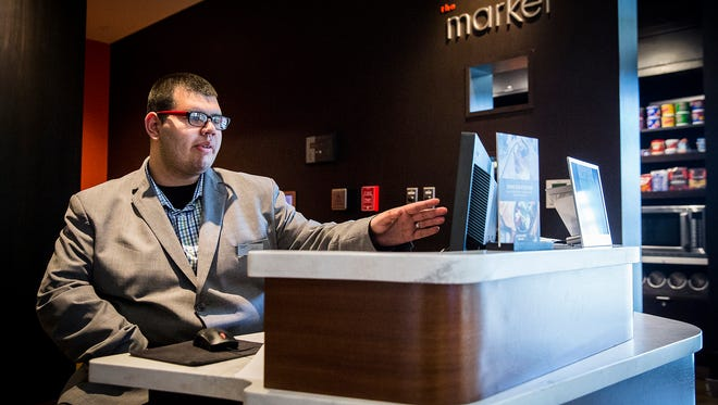 Alex Miguel Nunez, a graduate of the Erskine Green program, works a shift at the Courtyard by Marriott in downtown Muncie.