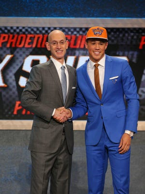 Jun 25, 2015: Devin Booker (Kentucky) greets NBA commissioner Adam Silver after being selected as the number thirteen overall pick to the Phoenix Suns in the first round of the 2015 NBA Draft at Barclays Center.