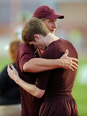 Forestburg's Styler Sandusky gets a hug from his father/coach, Steve, after finishing third in the Class 1A boys high jump during the UIL state track and field championships on Thursday, May 11, 2017, at Mike A. Myers Stadium in Austin.