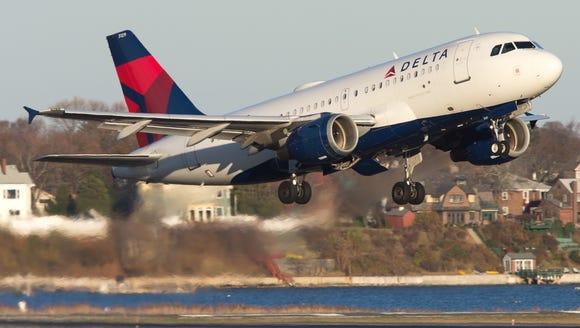 A Delta Air Lines Airbus A319 departs Boston Logan