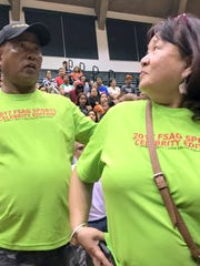 Rolly, left, and Tess Canoy, founders of the Filipino Sports Associatio of Guam, prepare to be recognized at the 2017 FSAG Celebrity Sprots Edition sponsored by Coldstone/Wendy's.  The duo put together an event on April 1, 2017 that featured Philippine Basketball Association Legends and Filipino TV and big screen celebrities taking on the FSAG Select team.