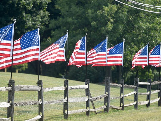 A line of flags stands along Old Forge Road in Annville
